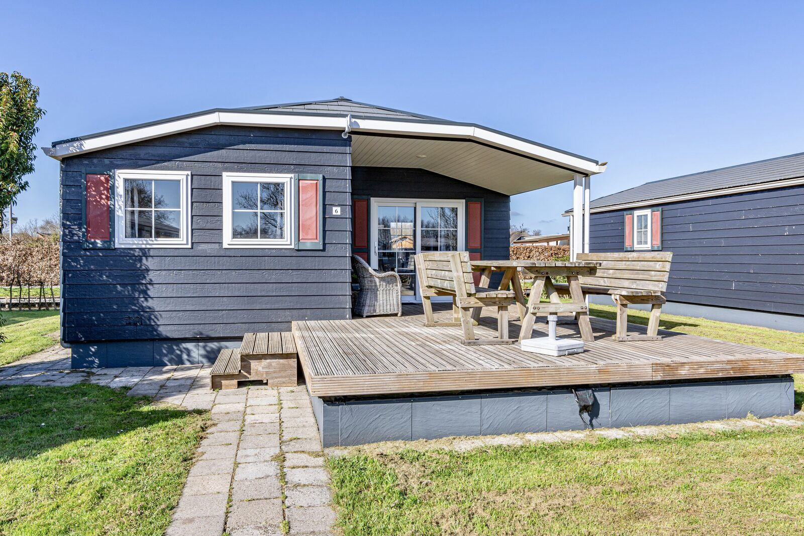 """Chalet """"De Grote Belter"""" four guests with a wooden porch"""