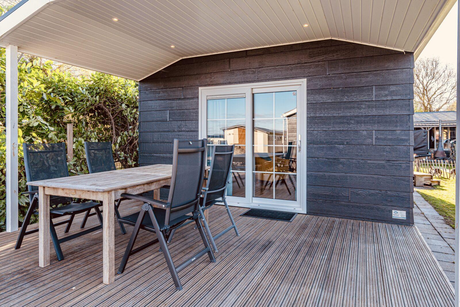 "Chalet ""De Kleine Belter"" four guests with a wooden porch"