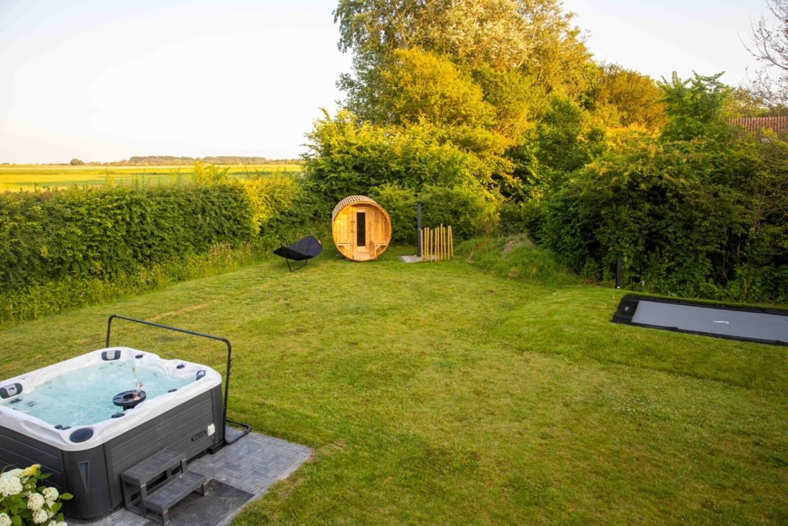 """Poldersbos 3 - Ouddorp """"BarLeDunes"""" with jacuzzi and sauna (extra costs fur use)"""